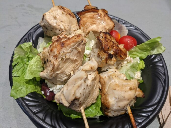 Get a chicken kabob over a Greek Salad at Lakeside Grill a new restaurant at SeaWorld theme park in Orlando, Florida