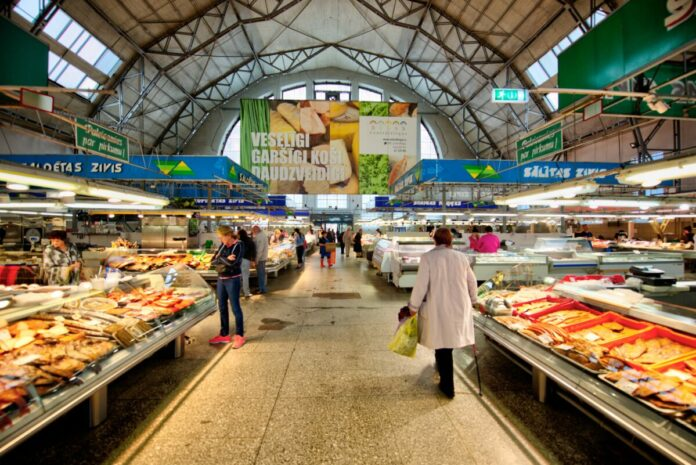 Discount price for guided walking & food tasting in the Central Market in Riga, Latvia