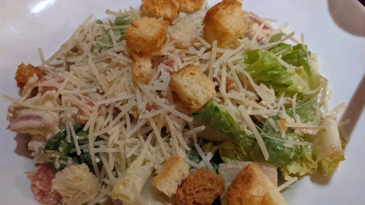 We love the salads like this chicken Caesar salad available at Blue Talon Bistro in Williamsburg, Virginia