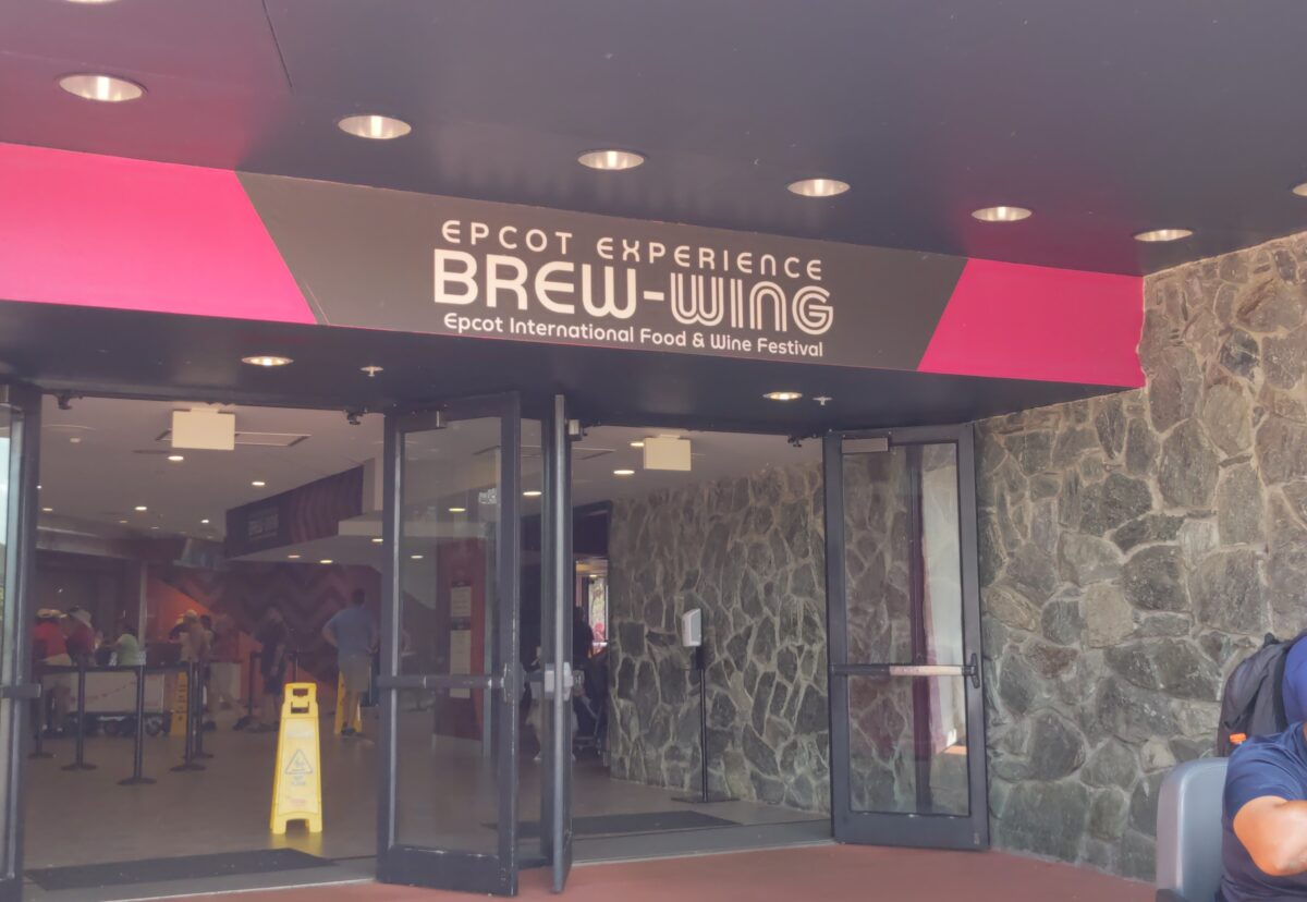 You can escape the heat by eating wings & pizza & drinking beer at the Brew-Wing at the Epcot Experience at Walt Disney World