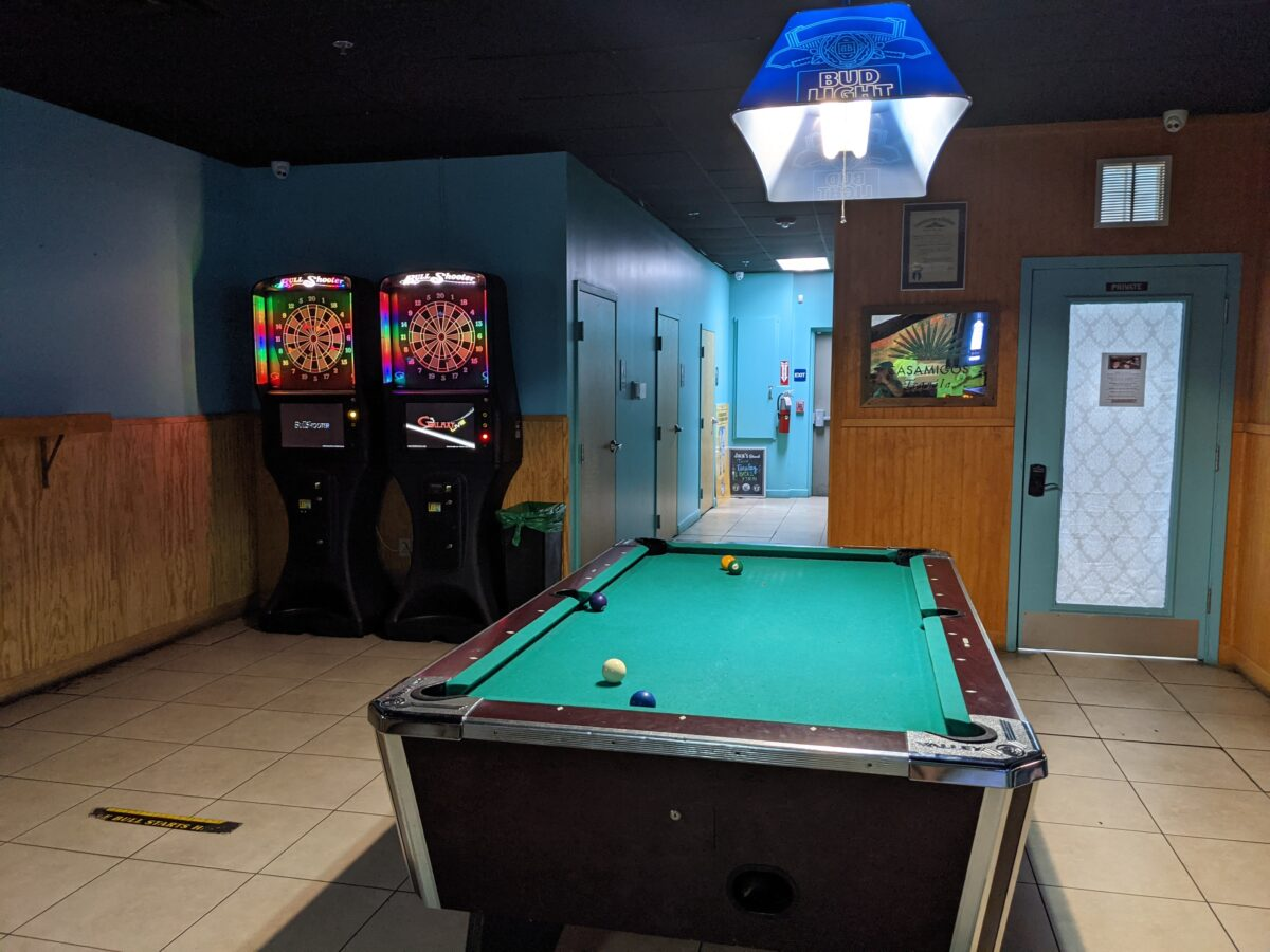 Pool and darts are in one of the rooms at Monkey's Uncle Tavern near the beach in Jax