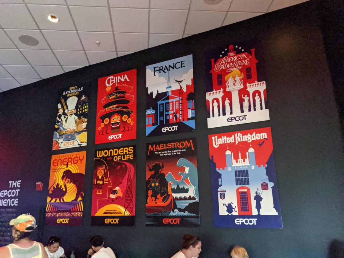 See Epcot attraction posters while eating food & drinking at Brew-Wing at the Epcot Experience in Disney World
