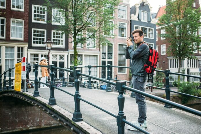 Discounted price for Amsterdam walking tour visit Chinatown, Jewish Quarter, Royal Palace, Canal District & more