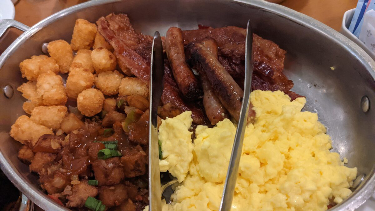 Beef hash, eggs, tater tots, and sausage are on the menu at Cape May Cafe at the Walt Disney World Resort
