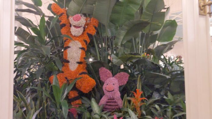 See Tigger, Piglet & other Hundred Acres Woods characters on display in topiary form at Crystal Palace in Magic Kingdom at WDW