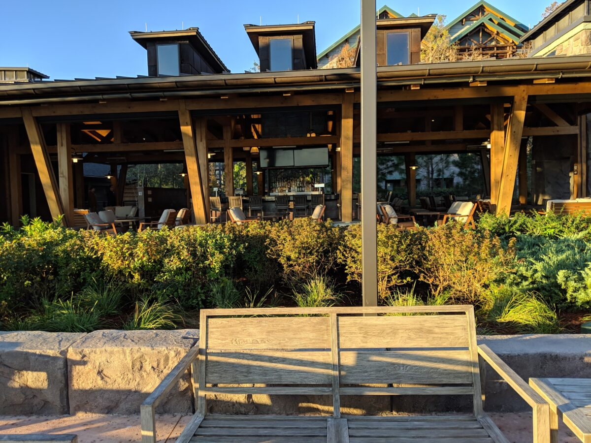 Relax outside under covered patio at Geyser Point Bar & Grill at Disney's Wilderness Lodge in Orlando