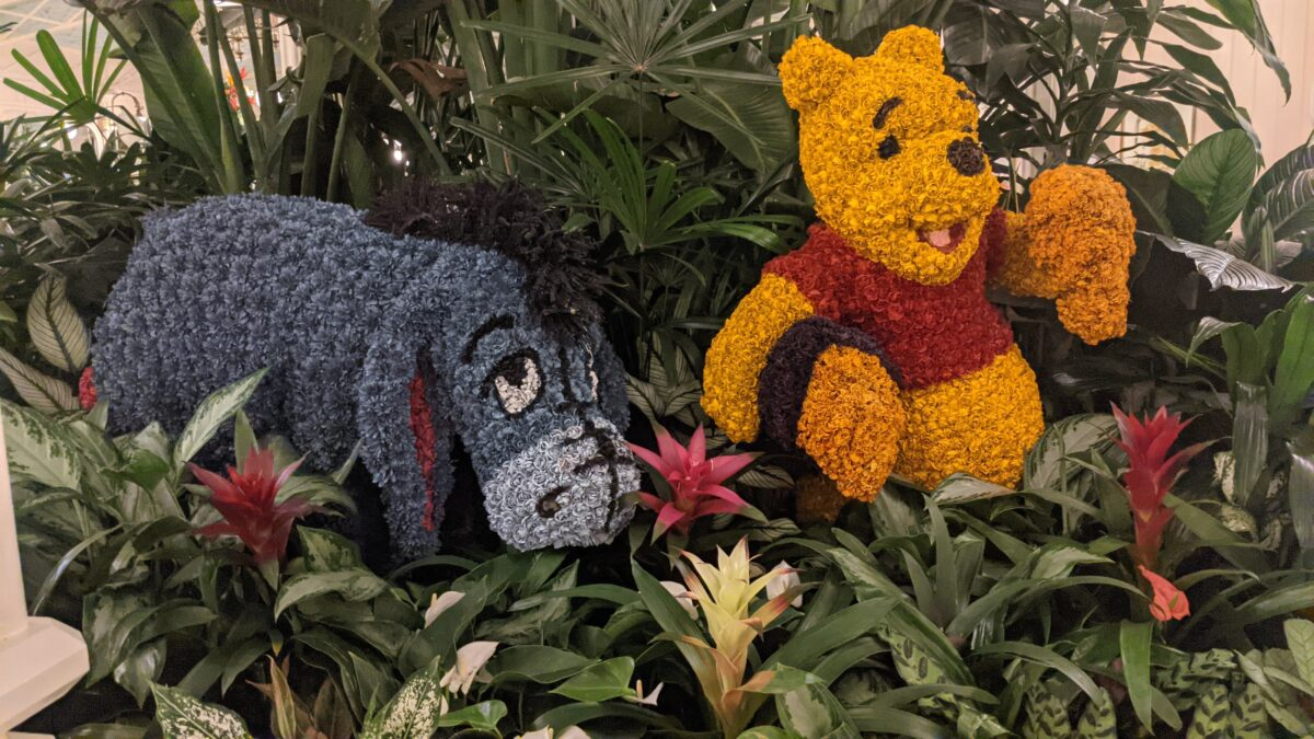 Crystal Palace restaurant on Main Street in Magic Kingdom at Disney World has Winnie the Pooh character topiaries