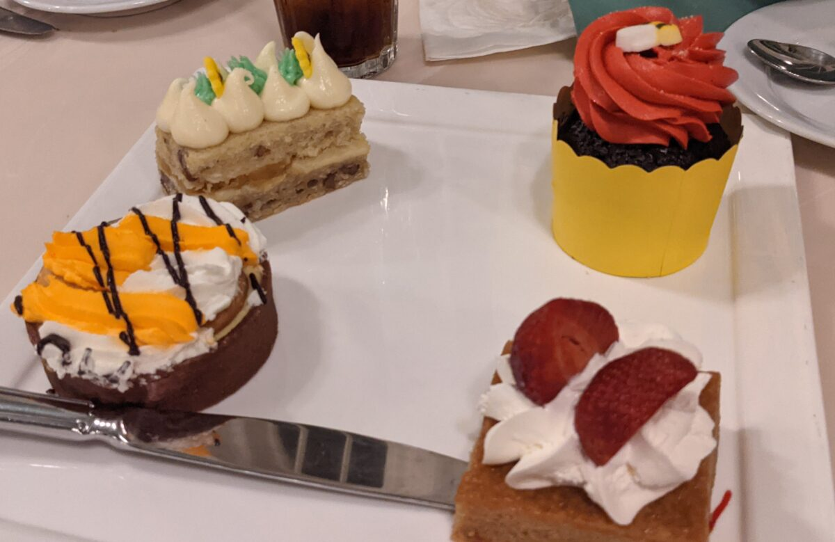 Strawberry shortcake, banana cream pie & a delicious cupcake are some of the desserts you can order as part of the buffet meal at Disney World's Crystal Palace