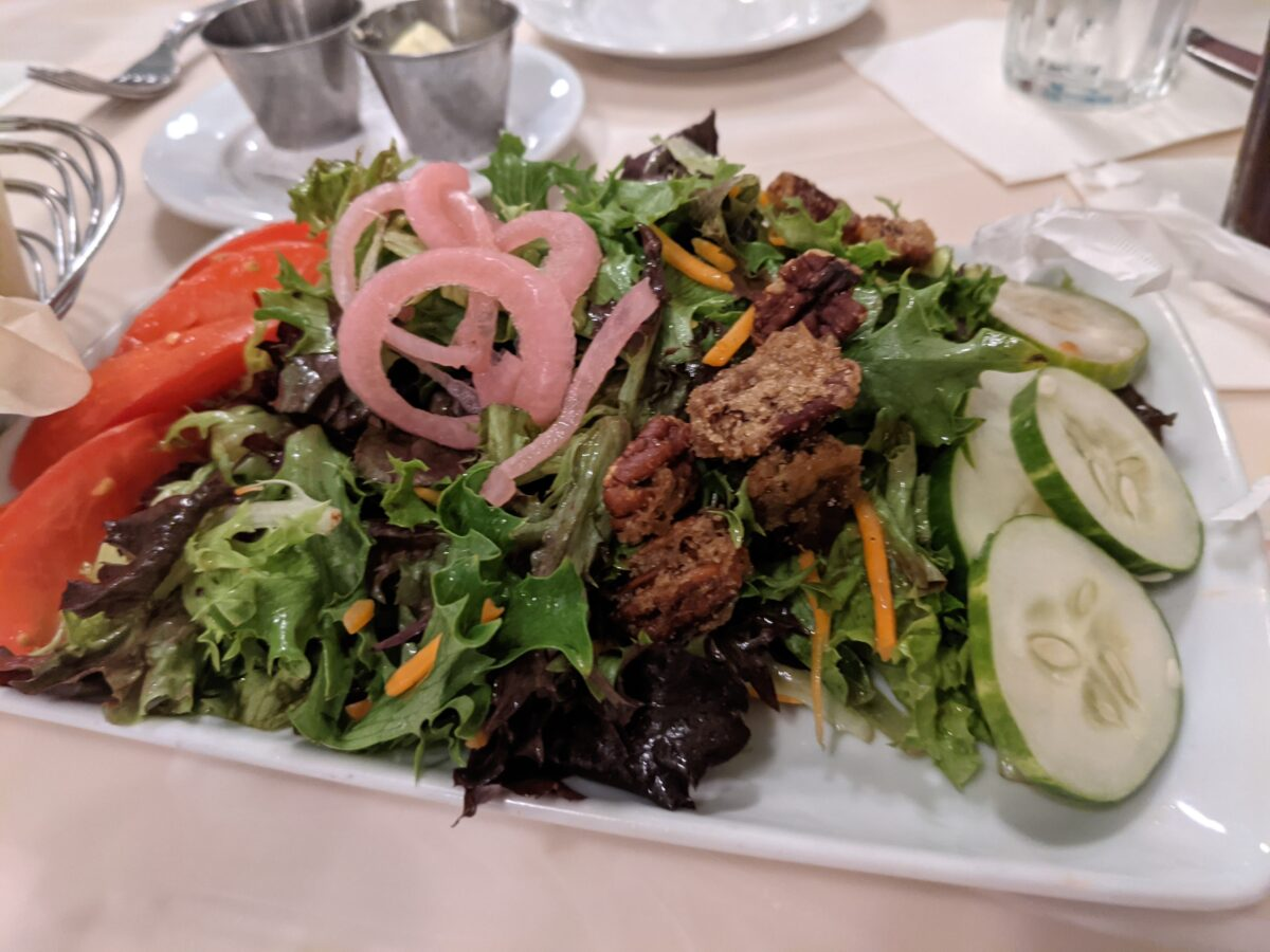 Crystal Palace at Disney World has a great salad with pickled onions, candied pecans, tomatoes, cucumbers, mixed greens & more