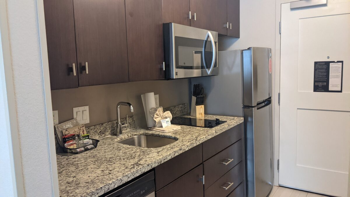TownPlace Suites SeaWorld in Orlando, FL has rooms with full kitchens including refrigerators, stove, and microwaves