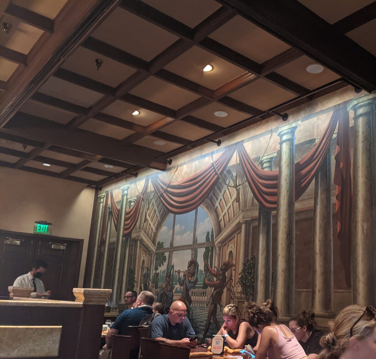 See columns & other Italy staples in artwork at Epcot's Italian restaurant, Tutto Italia