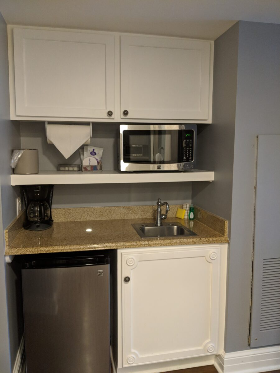 A picture of the kitchens at Disney's Beach Club villas including the dishwasher and microwave in Orlando, Florida