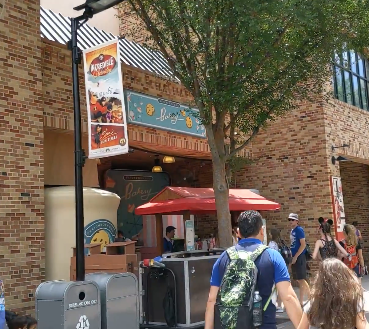 Eat cookies at the market that sells food in Hollywood Studios theme park in Orlando, Florida