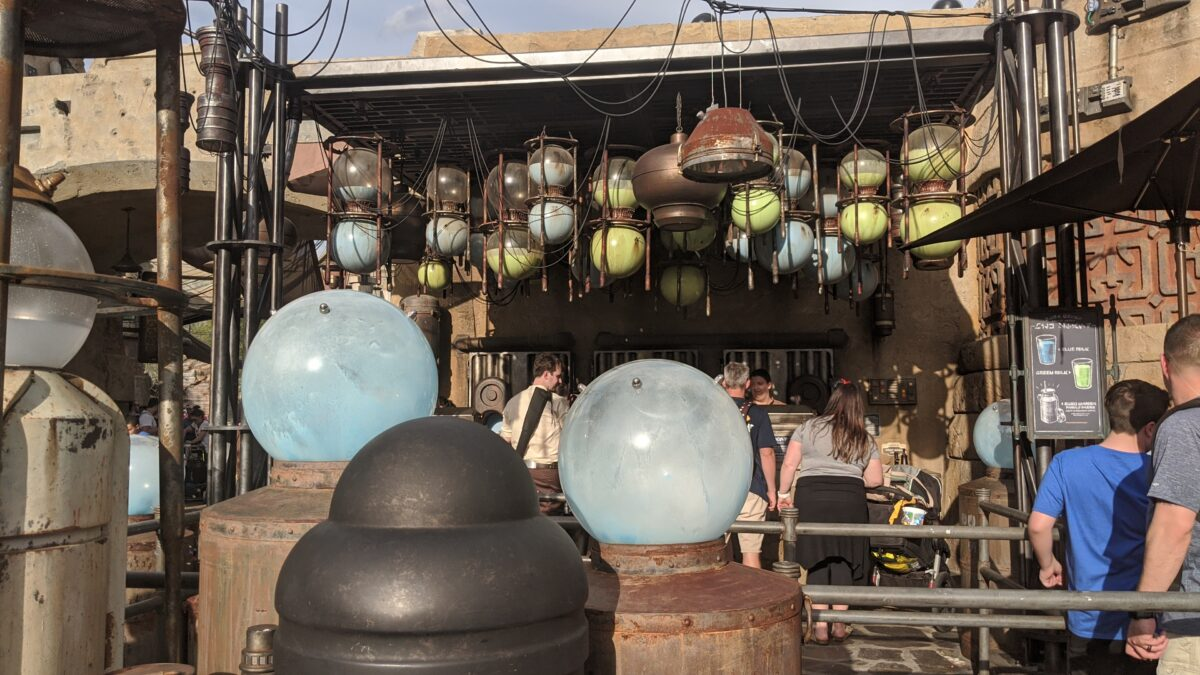 Milk Stand at Star Wars: Galaxy's Edge at Disney's Hollywood Studios with Blue and Green Milk