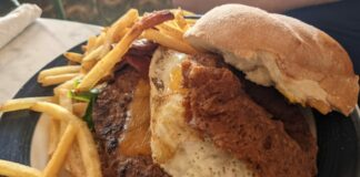 The Main Street Burger is a delicious burger with bacon and eggs available at the Magic Kingdom's Plaza Restaurant in Orlando, Florida