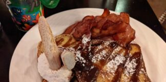 You can get bacon or sausage with your Tiramisu-style French Toast at the Italian restaurant Trattoria al Forno at the Walt Disney World Resort