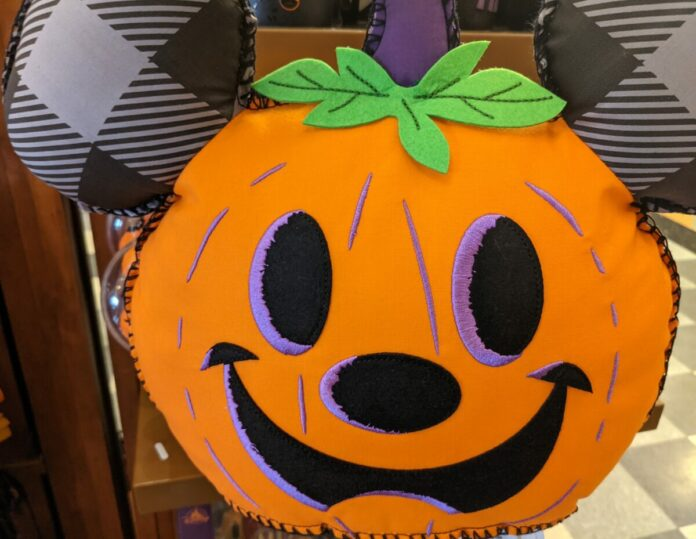 A picture of a Mickey Mouse pumpkin pillow. Find out what made our list of the best Disney Halloween pillows