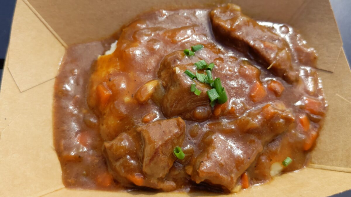 Epcot International Food & Wine Festival 2021 has a Belgium marketplace that servcs Beer-braised Beef & Mashed Potatoes
