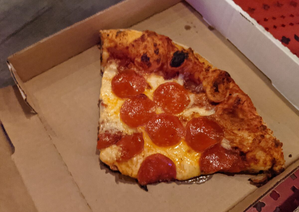A picture of the pepperoni pizza you can order at Disney's Boardwalk Pizza Window in Orlando, Florida
