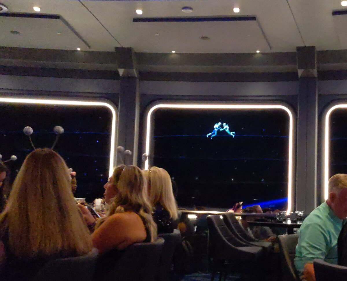 Two lover astronauts are romantic outside your window at Space 220 in Epcot at Disney World