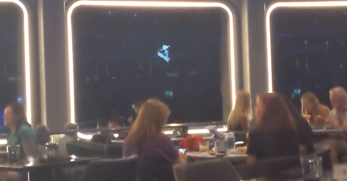 Space 220 has great visuals up while you eat, like this astronaut snowboarding in space