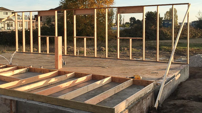 After waiting three days for the concrete slab to begin curing, Matt Bath began framing the first floor of his house. Advanced framing techniques will ...