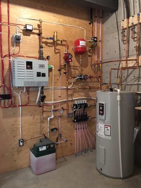 Heating a superinsulated house in a cold climate for Efficient hot water systems