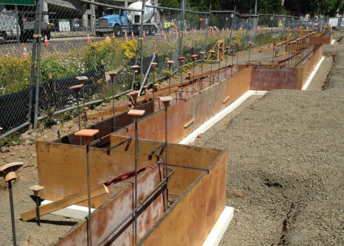 Placing a concrete foundation on rigid foam insulation for Basement wall forms