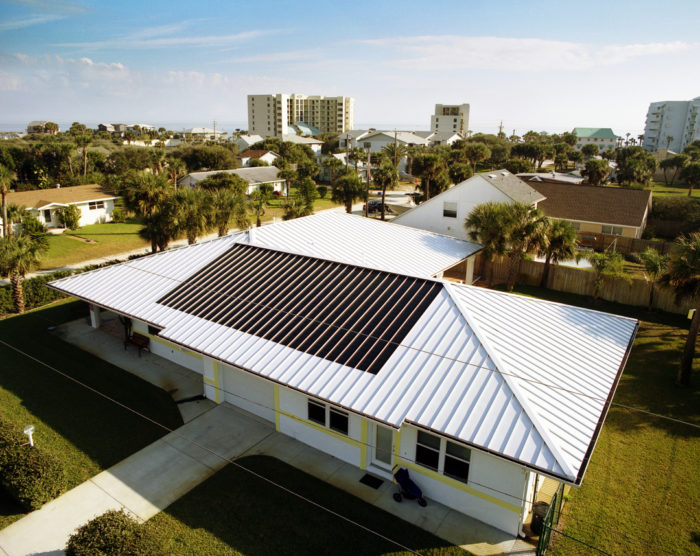Researchers from the florida solar energy center built this pv equipped model home in new smyrna beach florida the homes white metal roofing and wide