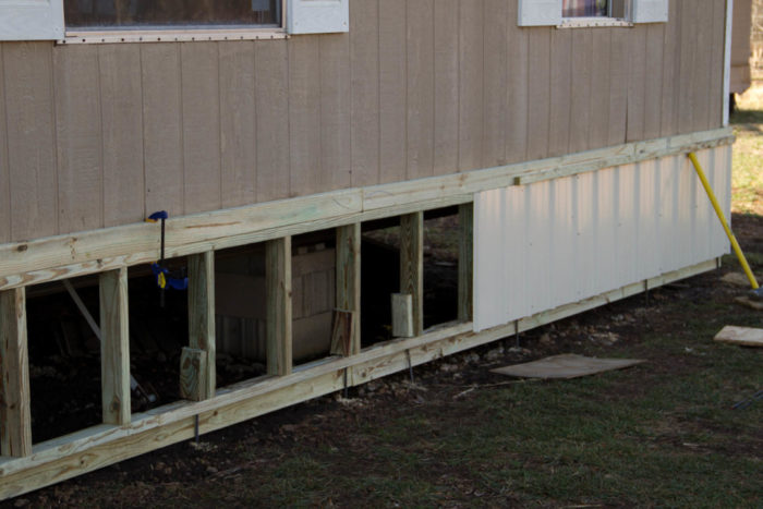 Crawl Spaces vs. Skirts - GreenBuildingAdvisor on mobile home siding, mobile home rails, mobile home decks, mobile home electrical, mobile home staircases, mobile home plumbing, mobile home doors, mobile home locks, mobile home garages, mobile home furnace, mobile home leveling, mobile home mirrors, mobile home porches, mobile home steps, mobile home carports, mobile home anchors, mobile home awnings, mobile home beams, mobile homes with blue roofs, mobile home landscaping,