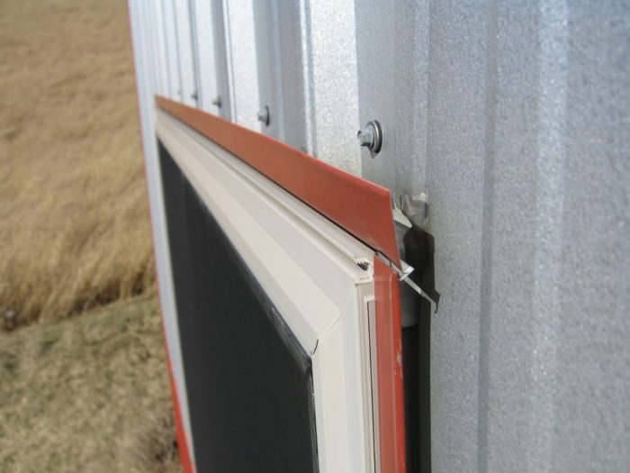 Metal siding — window head flashing detail