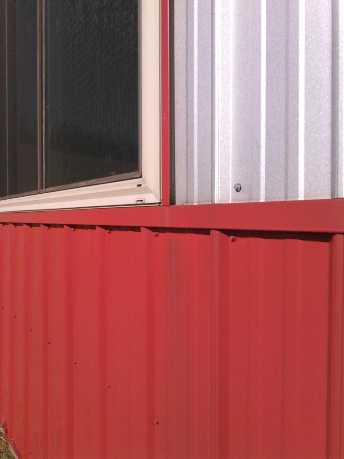 Metal siding — window head flashing detail