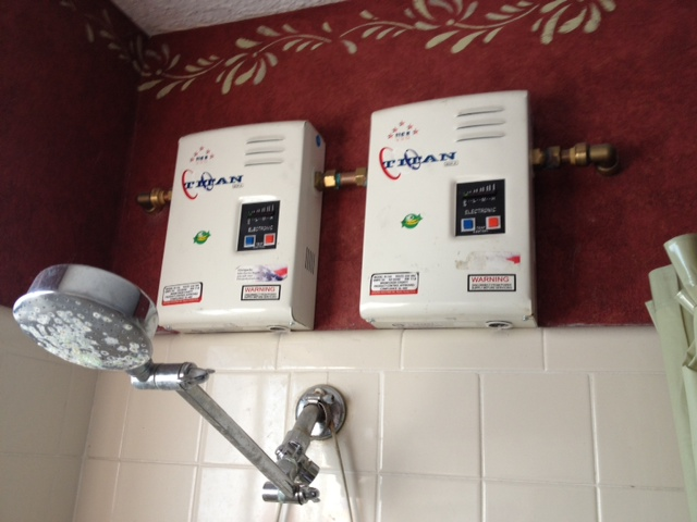 tankless electric water heaters can be installed in series two titan n 120 water heaters create very hot water even at high flow rates during the winter - Electric Water Heater Installation