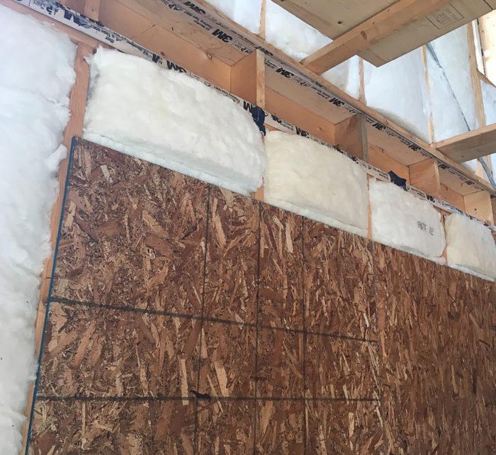 Flatrock passive insulation and an air barrier for Compressed fiberglass insulation