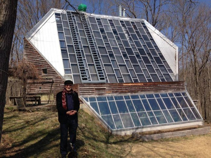 Richard Levine in front of his active and passive solar house built in the 1970s (Image by Energy Vanguard)