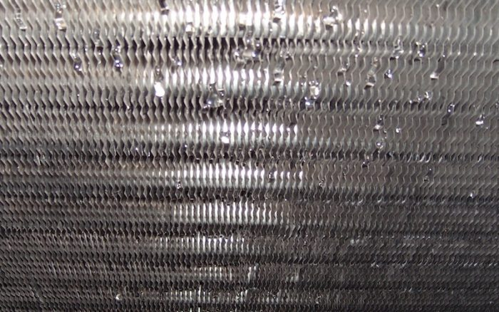 A clean air conditioner coil with no skin flakes. [Photo credit: Energy Vanguard]