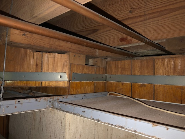 What is the source of the excess humidity that caused the water damage? [Photo credit: Energy Vanguard]