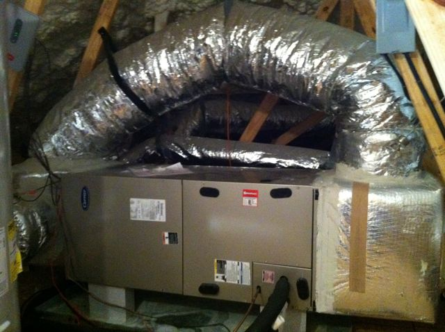A large bypass duct sending conditioned air directly back to the return side of the air handler
