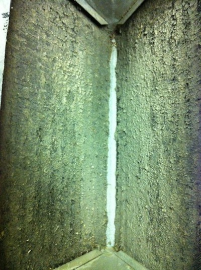 A dirty air conditioner evaporator coil with biofilms [Photo by Energy Vanguard]
