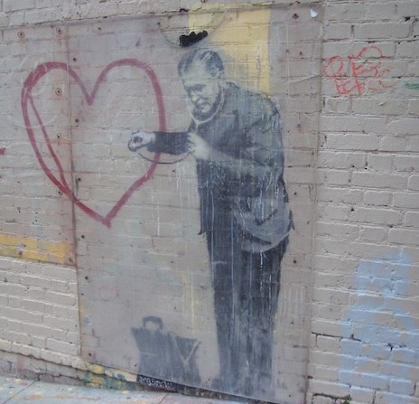 Love is more important than building science (photo of Banksy art in San Francisco, by Energy Vanguard)