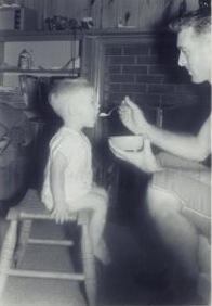 That's me as a toddler, getting fed by my dad