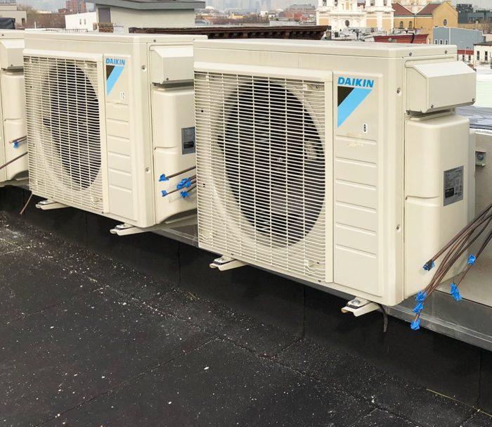 Photo of rooftop compressors for deep energy retrofits