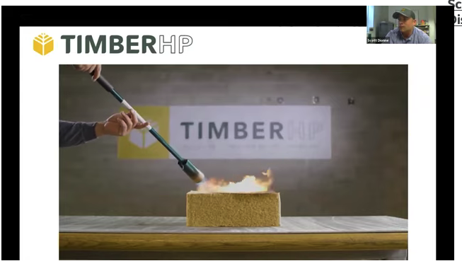 photo showing torch being used on wood fiber insulation