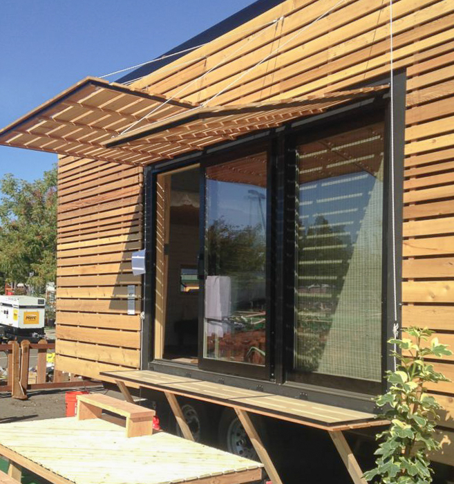 Photo showing wood shades shielding a large glass sliding door