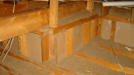 Uninsulated short attic kneewall that resulted from a ceiling height change