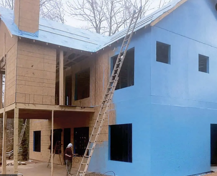 PolyWall Blue Liquid Wrap 2300 applied to a two-story home. Photo courtesy of manufacturer.