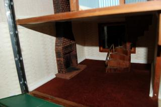 view of fireplace and curved staircase
