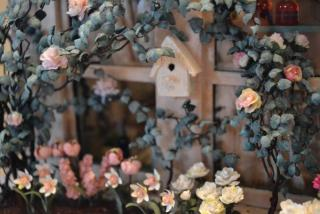 bird house and roses