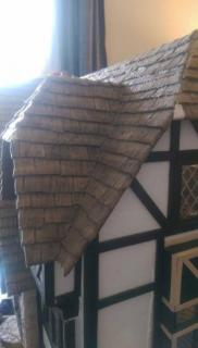 paperclay shingles have aged fairly well