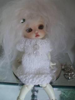i must apologise for all the dolly photos, i know this site is about dollhouse making , but she is so cute i couldnt resist